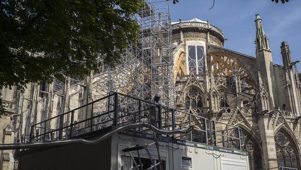 Scaffolding is erected during preliminary work to repair the fire damage (Rafael Yaghobzadeh, Pool/AP)