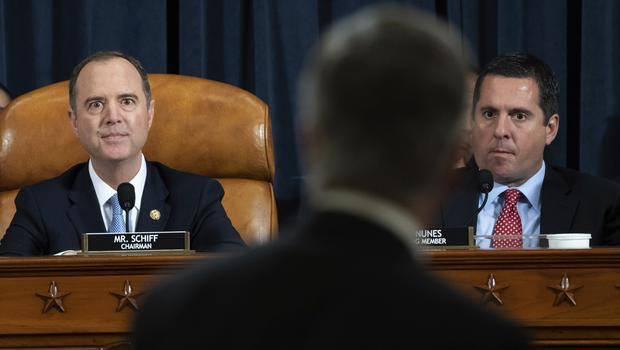 Adam Schiff and Devin Nunes watch as Top US diplomat in Ukraine William Taylor leaves after testifying at a hearing of the House Intelligence Committee (Saul Loeb via AP)