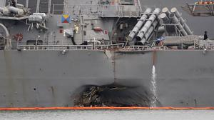 The damaged hull of the USS John S McCain after the destroyer collided with an oil tanker (AP Photo/Wong Maye-E)