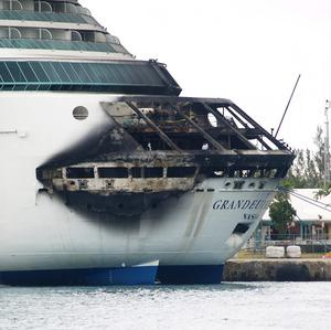 The fire-damaged exterior of Royal Caribbean's Grandeur of the Seas (AP/The Freeport News)