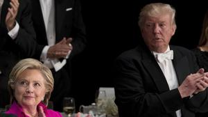 Bitter lemon, anyone? Hillary Clinton and Donald Trump could not resist trading barbs at the gala, but did shake hands at the end (AP)