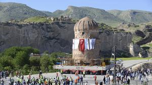 A 550-year-old tomb is moved on a large wheeled platform in the village of Hasankeyf, south-eastern Turkey (DHA-Depo Photos via AP)