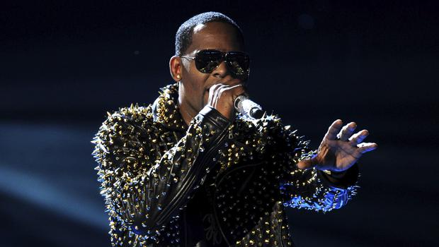 R Kelly on stage in LA as the singer is accused of sexual battery (Frank Micelotta/AP)