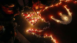 People light candles on an outline of the new map of Nepal drawn on a road (Niranjan Shrestha/AP)