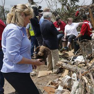 Oklahoma governor Mary Fallin picks up a toy from the rubble at Steelman Estates Mobile Home Park, which was hard hit in Sunday's tornado (AP)