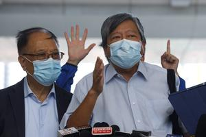 Pro-democracy activists Lee Cheuk-Yan, right, and Yeung Sum (AP Photo/Kin Cheung)