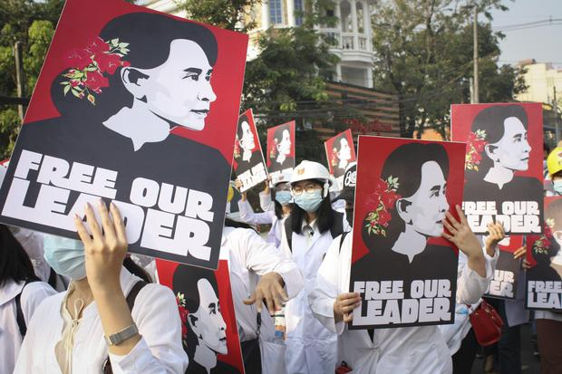Medicals students display images of Aung San Suu Kyi during a street march in Yangon (AP)