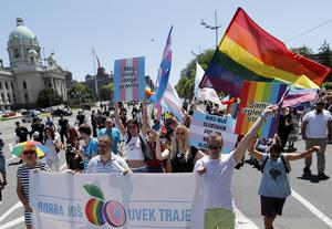 """Gay rights activists hold a banner that reads """"the battle still goes on"""" during a march in Belgrade, Serbia (Darko Vojinovic/AP)"""