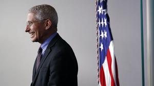 Dr. Anthony Fauci, director of the National Institute of Allergy and Infectious Diseases, smiles during a briefing about the coronavirus in the James Brady Press Briefing Room of the White House, Thursday, April 9, 2020, in Washington. (AP Photo/Andrew Harnik)
