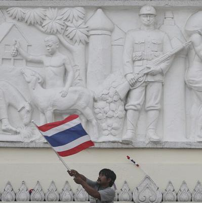 An anti-government protester waves a flag during a rally against the political amnesty bill in Bangkok (AP Photo/Sakchai Lalit)