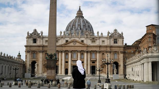 A nun stands in St Peter's Square at the Vatican (Gregorio Borgia/AP)