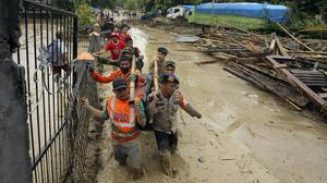 Heavy rains cause frequent landslides and flash floods in Indonesia (AP)