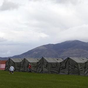 Children play in front of tents after the strong earthquake (AP Photo/Nikiforos Stamenis)