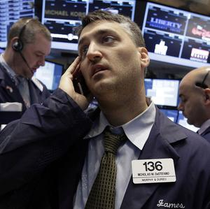 Trader Nicholas DeStafano works on the floor of the New York Stock Exchange (AP)