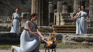 Greek actress Xanthi Georgiou, playing the role of the high priestess, during the flame-lighting ceremony at the Ancient Olympia site in southern Greece (Thanassis Stavrakis/AP)