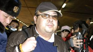 Pictured in 2007, a man believed to be Kim Jong Nam is surrounded by the media at Beijing airport (Kyodo News via AP)