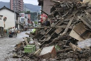 Rescue operations continued and rain threatened wider areas of the main island of Kyushu (Kyodo News via AP)