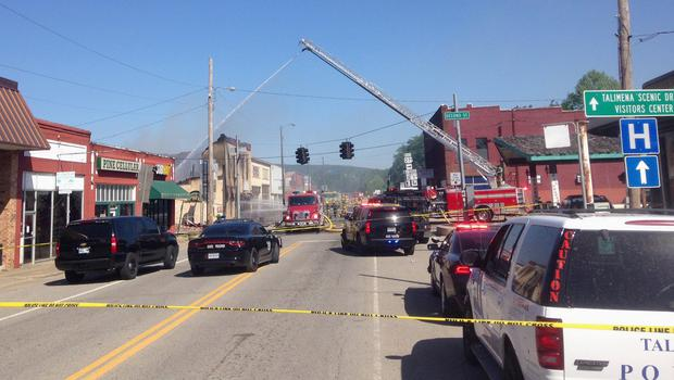 Emergency vehicles block a street in downtown Talihina after a large fire began (Max Bryan/The Southwest Times Record via AP)