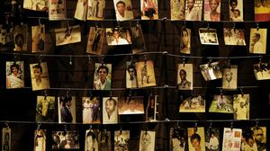 Photographs of some of those who died, at an exhibition at the Kigali Genocide Memorial centre (Ben Curtis/AP)
