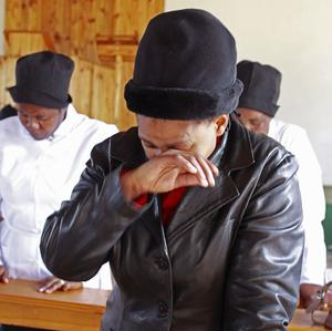 A woman weeps as she and others pray for Nelson Mandela at the Presbyterian church, at the Nelson Mandela museum in Qunu (AP)