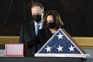 Vice President Kamala Harris and her husband Doug Emhoff pay their respects (Anna Moneymaker/The New York Times/Pool/AP)
