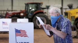 Voters in Wisconsin cast ballots at polling places for the state's presidential primary election, ignoring a stay-at-home order over the coronavirus threat (John Hart/Wisconsin State Journal via AP)