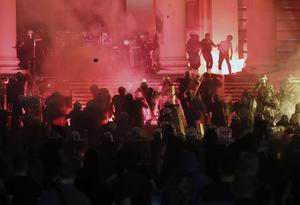 The protests have been centred on the Serbian parliament building in Belgrade (Darko Vojinovic/AP)