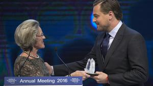 Chairwoman and co-founder of the Schwab Foundation Hilde Schwab, left, presents Leonardo DiCaprio with the Crystal Awards (AP)