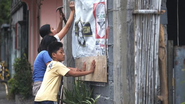 Residents reinforce their house as they prepare for Typhoon Kammuri (AP)