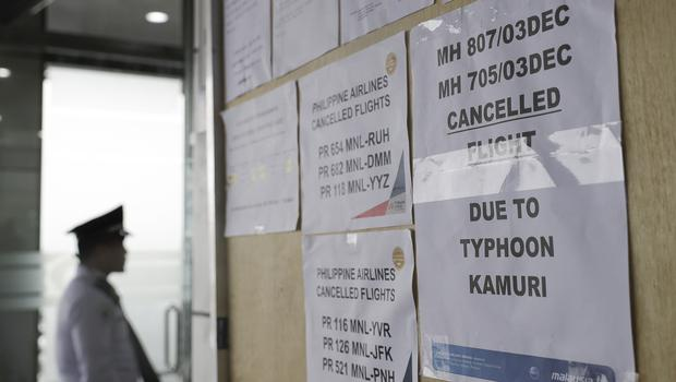 A sign is placed outside the entrance of Manila's International Airport after flights were cancelled due to the approaching typhoon (Aaron Favila/AP)