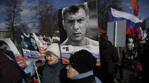 People march in memory of opposition leader Boris Nemtsov, who was killed two years ago in Moscow, Russia (AP/Pavel Golovkin)