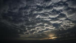 Clouds form over the city of Kolkata in West Bengal (Bikas Das/AP)