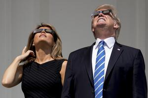 President Donald Trump and First Lady Melania Trump wear protective glasses as they view the solar eclipse at the White House (Andrew Harnik/AP)