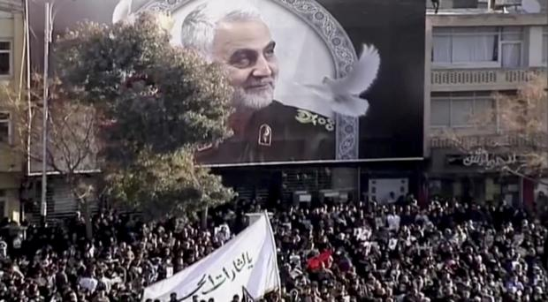 Mourners gather to pay their respects to General Qassem Soleimani in Kerman, Iran (Iran Press via AP)