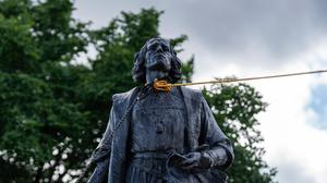 Two ropes are tied around the neck of a Christopher Columbus statue before a group of people pulled it down (Evan Frost/Minnesota Public Radio via AP)