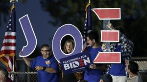 Supporters hold a sign before a campaign rally for Democratic presidential candidate former Vice President Joe Biden (Marcio Jose Sanchez/AP)
