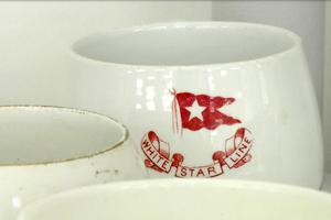A mug displaying the logo of British shipping company White Star Line, which operated the Titanic, at RMS Titanic, Inc's storage facility in Atlanta. (Angie Wang/AP)