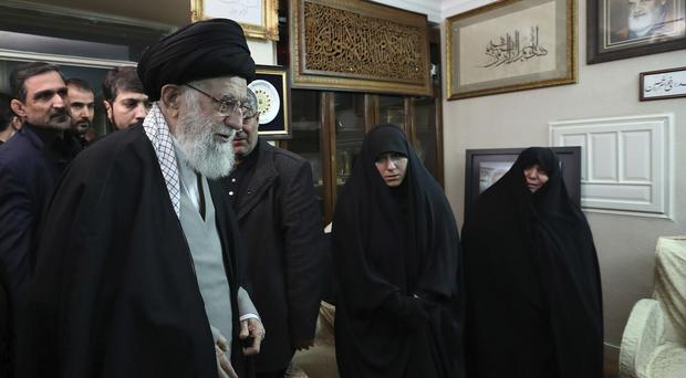 Iran's Supreme Leader Ayatollah Ali Khamenei meets family of General Qassem Soleimani, who was killed in Friday's US air strike in Iraq (Office of the Iranian Supreme Leader/AP)