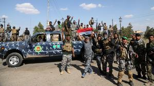Iraqi security forces prepare to attack Islamic State positions in Tikrit. (AP)