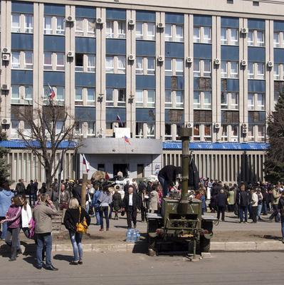 Pro-Russian activists gather in front of an entrance to the Ukrainian regional office of the Security Service in Luhansk (AP)