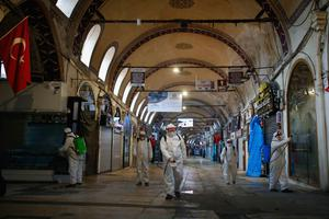 Workers spray disinfectant at the Grand Bazaar in Istanbul