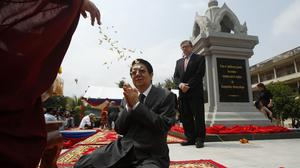 Cambodian deputy prime minister Sok An prays during a ceremony inaugurating a memorial in Tuol Sleng Genocide Museum in Phnom Penh (AP)