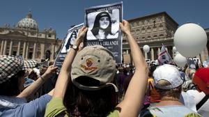 Demonstrators hold pictures of Emanuela Orlandi in St Peter's Square (Andrew Medichini/AP)