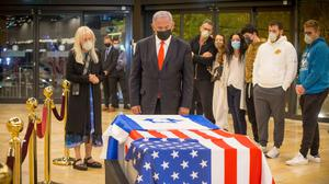 Israeli prime minister Benjamin Netanyahu stands before the coffin of Sheldon Adelson (Ami Shooman/AP)