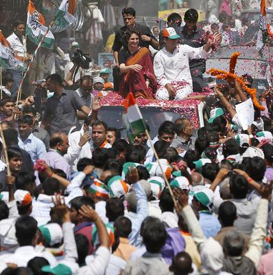 Vice president of India's ruling Congress party Rahul Gandhi waves to supporters, with his sister Priyanka Vadra (AP)