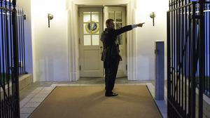 A Secret Service agent giving directions during an evacuation from the White House. (AP)