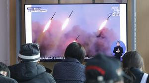 People in South Korea watch a TV showing old images of North Korean missile launches (Ahn Young-joon/AP)