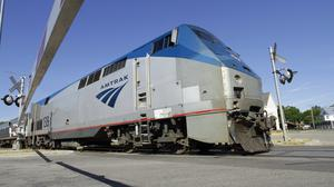 An Amtrak commuter train hit a lorry on tracks in North Carolina