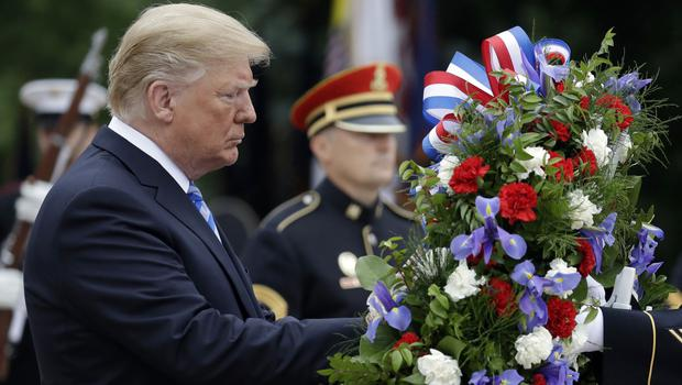 President Donald Trump participates in a wreath laying ceremony at the Tomb of the Unknown Solider (Evan Vucci/AP)