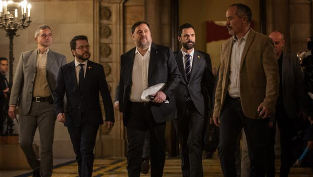 Catalan politician Oriol Junqueras, centre, arrives at the Parliament of Catalonia in Barcelona (Emilio Morenatti/AP)